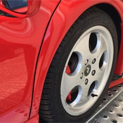 red sports car wheel