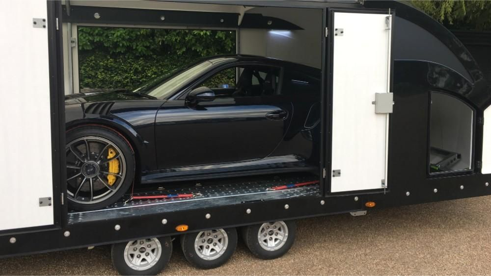 Black sports car in our truck